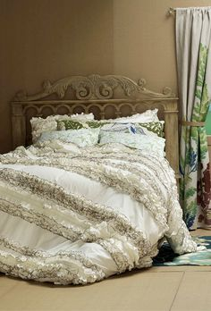 Gorgeous ruffled bedding.  I love the ruffle trends going on today.  So much fun, life and so romantic!