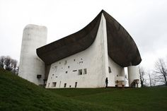 """Ronchamp : Le Corbusier.   Informally known as """"Ronchamp"""", the chapel of Notre Dame du Haut in Ronchamp (French: Chapelle Notre-Dame-du-Haut de Ronchamp), completed in 1954, is one of the finest examples of the architecture of Franco-Swiss architect Le Corbusier and one of the most important examples of twentieth-century religious architecture."""