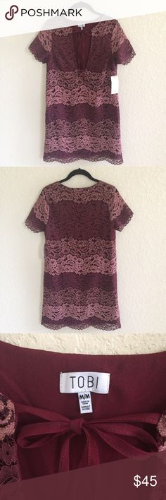 NWT Tobi Burgundy Lace Dress Open Front Tie NWT Tobi Burgundy Wine Lace Dress Open Front Tie. Color block detail. Fully lined. Perfect dress for your next event! Tobi Dresses Midi