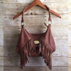 Boho Fringe Bag This bag looks makes every outfit better! •There are signs of wear but they can't be seen when on shoulder.  •There is a tear inside in the lining & markings wear under the shoulder strap. •🔹🔹Prices are as listed and nonnegotiable🔹🔹 ✅Use the Bundle Feature to receive 10% off 2 + items & save on shipping ❌But there are no additional discounts Buffalo Bags Shoulder Bags