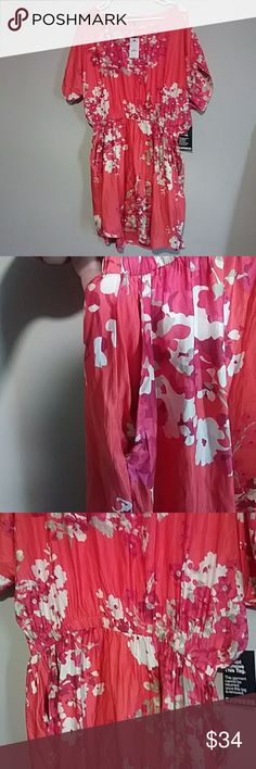 NWT silky Express floral dress Gorgeous bought brand new now too big. Beautiful cinched elastic waistline, solid coral with a white and pink floral pattern throughout. Simple and perfect. Wide short sleeves, scoop neck style, super silky soft 100% polyester make offer Express Dresses