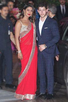 Priyanka Chopra's red Abu Jani Sandeep Khosla sari came with a sexy strappy mirror work blouse   VOGUE India