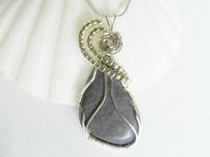Wire Wrapped Pendant, Burro Creek Jasper. Stone size: 37 x 25 mm (1.44 x .97 inches). This stone was cut and polished by GaddaboutRock. Jasper is a stone of gentleness