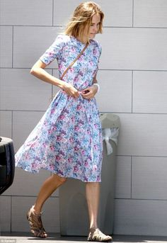 Actress and model, Isabel Lucas, floral cotton dress, flat sandals and shoulder bag.
