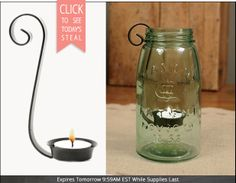 This would be easy to copy:  stiff enough wire for the curly holder, then wrap it around a glass votive holder (we all only have about a million of those).  This was from Decor Steals but were too expensive to have a whold bunch.