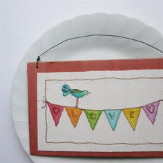 Embroidered on card stock and then water colored over top - it gives it a very cool look!