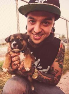 Tony Perry ~Pierce The Veil-Day7.He is with a puppy and Tony is smiling!!!! My day is made.