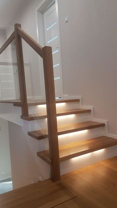 Easy to copy stairwell lighting, railings, and branding decor. Over twenty easy to copy starirwell lighting, railings, and branding decor ideas. Staircase Handrail, New Staircase, Wooden Staircases, Stair Railing, Staircase Design, Stair Lighting, Home Lighting, Interior Stairs, Home Interior Design