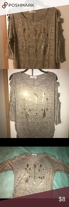Juniors peek-a-boo shirt Juniors light brown and cream shirt. Gold arrows on front.  3/4 sleeves with peek-a-boo cut outs on sleeves. Slight gathering on sides. New without tags. NEVER WORN! Rue Juju Tops Blouses