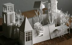Charles Young spent a year crafting 365 tiny paper buildings and doing stop motion photography to bring them to life.