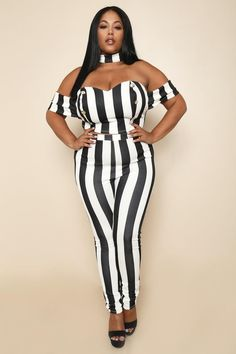 It takes two to make a thing go <i>haute!</i> This plus size pants and crop top set features a matching stripe print fabric that will have all eyes on you. Crop top features a built-in choker, off-shoulder sleeves, sweetheart neckline, and 3-tiered button embellishments at the sides. Pants are crafted with a high elasticized waist and body-hugging fit.