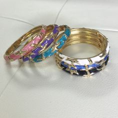 "🆕 OJDC HWN Bangles Beautifully crafted, Hawaiian bangles.  Gold tone with hand painted enamel designs. this bracelet features a starfish. Fits wrist sizes 6.5"" - 8.5"" because of the wide hinge opening for easy on and off. Ocean Jewelers Jewelry Bracelets"
