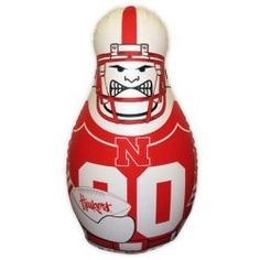 Nebraska Cornhuskers Tackle Buddy Punching Bag by Fremont Die. $26.99. A great way to burn off some of that pre game energy! Purchase your favorite team or the team you love to hate! They are constructed out of durable vinyl and are sand weighted for bounce back action. Measures 24 inches by 40 inches and inflates with any standard air pump.