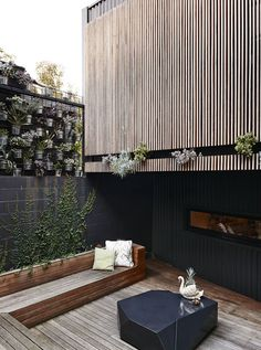 """Wood cladding, deck and built-in bench. """"The Melbourne Home of Kim Victoria Wearne and Stuart Beer via the Design Files. Outdoor Areas, Outdoor Rooms, Outdoor Living, Outdoor Decor, Design Exterior, Interior And Exterior, Interior Ideas, Landscape Design, Garden Design"""