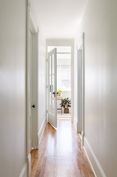 The upstairs hallway now has two bedrooms on one side and two bathrooms on the other, and ends at the glass door of the study. #dwell #homerenovation #chicago #victorian #beforeandafter