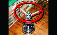 Steering wheel table from Car and Driver's 10 Best Car Parts for Home Decor.
