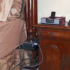 "CPAP Beside Holder: 8"" x 12"". Saves nightstand space by holding the machine in the space between the nightstand & bed. Keeps nightstand clutter free for other items. The machine is closer to you, the tubing has a greater length & moveability. Machine rests securely,held in place by a velcro strap. Any water leaks should be caught inside the tray, protecting floors & furniture. Removing the machine (for cleaning) is easy-undo the strap-lift machine out. No modifications to bed or frame…"
