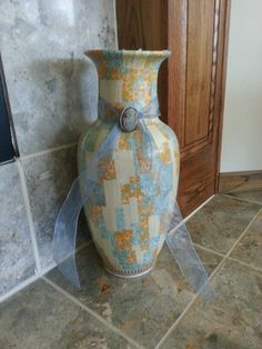 My favorite so far! Huge, porcelain vase decoupaged for in front of my fireplace