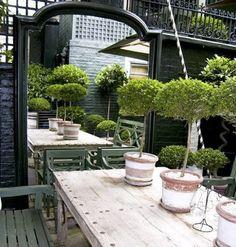 make a small garden look big with an outdoor mirror
