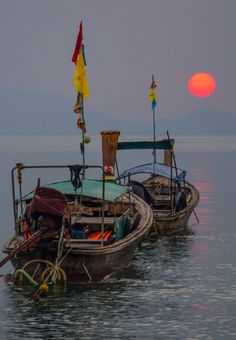 Longtail boats and a picture-perfect sunset in Krabi, Thailand  #travel #thailand #krabi #sunset