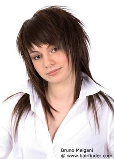 Spiky layered hair. Love the bangs on this cut!