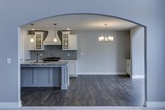 Mayfair Kitchen & Dining Room- Eastbrook Homes, MI #NewHome #RealEstate #WoodFlooring #Arches #BeautifulKitchen #EastbrookHomes