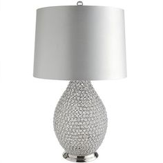 Countless crystal beads are individually strung to create this lamp's stunning vase, allowing you to see its outer form and inner beauty. The white satin shade, lined with reflective silver, is topped with a faceted crystal ball finial to focus its allure. Is it working?