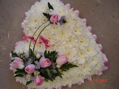 In the shape of a heart a funeral wreath.  Stay healthy and get 90-Day Results in Just 10 Days with http://phporder.com/Transformation.aspx?ID=healthwise
