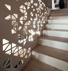 This staircase was designed by Italian studio Ego VitaminaCreativa for a duplex in northern Italy.the staircase is covered with a laser cut painted metal panel that lets light go through and project shimmers on the walls.