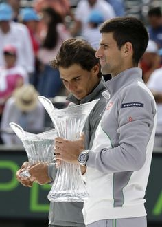 Rafael Nadal, of Spain, left, and Novak Djokovic, of Serbia, right, pose with their trophies after Djokovic defeated Nadal 6-3, 6-3 in the men's final at the Sony Open Tennis tournament, Sunday, March 30, 2014, in Key Biscayne, Fla. (AP)