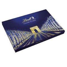 Le packaging secondaire classique du coffret Champs Elysées est le format familiale rectangulaire sur un niveau. On remarque la représentation des Champs Elysées sur le packaging en surimpressions dorées qui donne au coffret tout son aspect chic et festif et qui le destine ainsi aux célébrations de fin d'années et occasions spéciales.