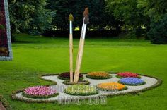 Conceptual artistic sculpture made from flowers Paint brushes and palette stock photo. Totally making this in my yard next spring!! So cool!