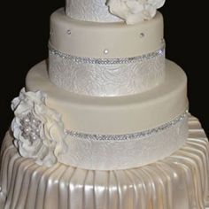 Your wedding cake doesn't need to be over-the-top to make a lasting impression. These classic cakes are dressed up ribbons, flowers (both real and sugar), cake jewelry, and traditional piping.