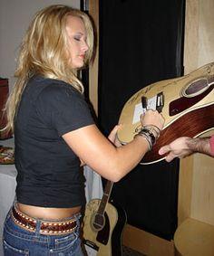 Miranda Lambert signs a guitar to be given away by Top Twenty Countdown. Miranda Blake, Blake Shelton Miranda Lambert, Miranda Lambert Photos, Beautiful Women Pictures, Amazing Women, Miranda Lambert Bikini, Country Girls, Country Music, Maranda Lambert