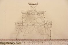 an antique french wire tiered plant stand.... love of french wire will never end