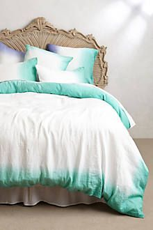 Link to anthropologie. I could easily get a white duvet cover and dye the edges. So pretty and simple!