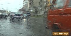Traffic In City 09 ...  city, diffuse, drops of rain, gloomy, go, gray, man, noise, pedestrian traffic, rain, road, traffic car, wet, windshield