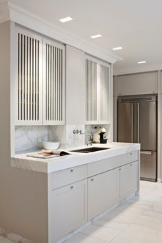 Louvered style doors, thick marble countertops by estella