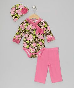 This darling bodysuit tempers its wild print with an abundance of sweet floral embellishments and a ruffled surplice cut. Matched by a tulle-touting beanie and an elastic waistband on the matching pants, it's full of precious touches and comfy charm.