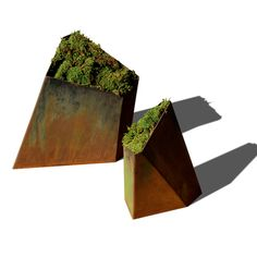 Architectural planters. Need a few of these sprinkled around - filled with succulents.