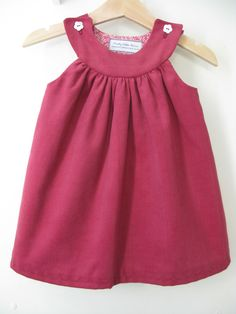 Raspberry baby cord dress with shoulder button fastenings(available 1-3 years) from £28