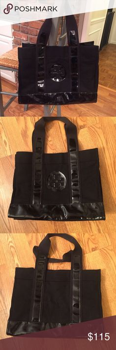 Tory Burch Tote Great large bag that will hold many large items. Material on outside is wool and polyester. Inside is cotton. There are some scratches on the patent leather which is not really noticeable. Overall the bag is in very good condition. Inside is in great condition. Tory Burch Bags Totes