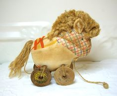 vintage quilted handmade pony with wooden spools