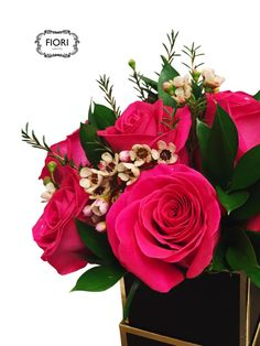 Luxury Dozen Rose in a Box A valentines day flower combination of romantic pink roses in a dramatic black box. Free Oakville delivery.