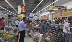 FILE -- In this Monday, June 5, 2017 file photo, provided by Doha News, shoppers stock up on supplies at a supermarket in Doha, Qatar after Saudi Arabia closed its land border with Qatar, through which the tiny Gulf nation imports most of its food. Qatar said Monday, June 12, 2017, that it had begun shipping cargo through Oman to bypass Gulf countries that have cut off sea and land routes to the tiny, energy-rich nation, the latest move by Doha to show it can survive a diplomatic dispute…