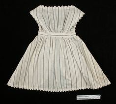 Pinafore, off-white cotton, brown striped print, 1868