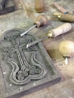 Bookend being created in Vardinis. Beautifully carved cross stone khachkar design.