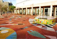 The Adrienne Arsht Center for the Performing Arts of Miami-Dade County - Miami, FL.  Rustic terrazzo covers outdoor spaces. Normally installed with cement terrazzo, the surface is able to support slip resistance in different weather conditions.