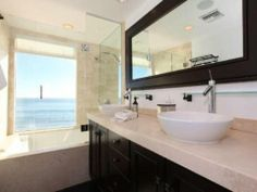Contemporary bathroom with black wood framed vanity mirror #designmine