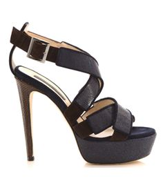 Navy sandals with stingray and suede trim. Open toe and two cross over front wide straps. Ankle strap with buckle. Brown stingray heel.